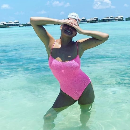 Chrissy Teigen Wears Pink One-Piece on Vacation With Family
