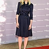 Kirsten pulled off the belted trench-cum-dress look to perfection at The Hollywood Reporter's annual Women in Entertainment breakfast in July 2011. She paired a quilted Chanel bag and Dolce & Gabbana pumps with her belted navy blue Burberry trench coat.