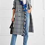 Show your girlie streak in heritage checks mixed with frills and a bold shot of cobalt. This MSGM Ruffled Checked Cotton-Blend Coat ($985) is a wow-worthy investment piece.