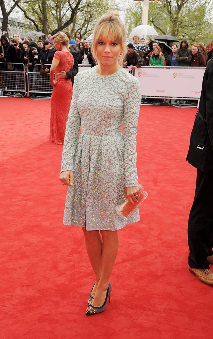 Sienna Miller wore a blue frock.