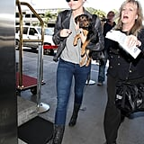 Miley Takes Flight With Her New Pup, Happy