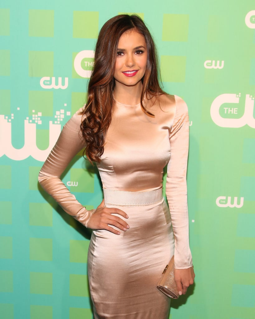 Nina Dobrev posed for cameras while attending the CW Upfront in NYC.