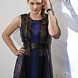 A closer look at Kristen's semisheer lace-paneled dress and harness belt.