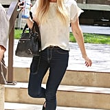 Lauren paired her dark denim skinnies with a white lace top and basic black flats in LA. Lesson from Lauren: a few posh accessories elevate casual separates.