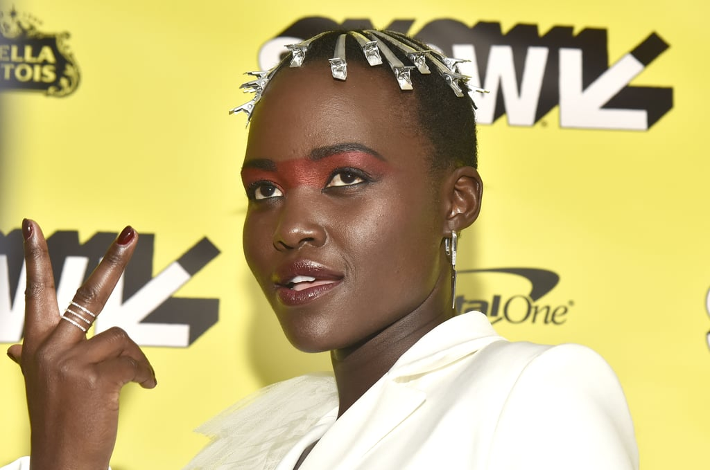 "The mystery surrounding Jordan Peele's Us has now crept its way into Lupita Nyong'o's red carpet style. As a star of the film, the 36-year-old actress made an appearance at the movie's SXSW premiere on March 8, and her look was hauntingly brilliant.  Nyong'o, known for her bold beauty decisions, wore sectioning clips throughout her hair.  Yep, the ones typically used when you sit in the salon chair. According to Variety, there was a very specific message behind this beauty choice.  ""This film is about bringing the darkness to the fore, the things that are hidden out,"" Nyong'o told Variety. ""My hair is inspired by that: the processes that we often hide, making it part of the outside vision.""  In addition to the movie, Nyong'o was also modelled after a certain rapper. ""It was also inspired by Snoop Doggy Dogg,"" she added. ""An image I love of his.""  True to Nyong'o's fashion, the meaning behind her look continued beyond the hair. She also cited '80s disco as an influence for her statement eye shadow, since the decade played an important part in Us. Ahead, see close-up photos of N'yongo's makeup and hair.       Related:                                                                                                           Nothing to See Here, Just the Most Cutting Edge Celebrity Hair Transformations of 2019"