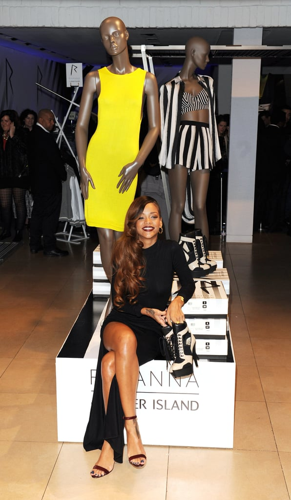 At the capsule collection's official store launch party, Rihanna donned a black long-sleeved dress that also featured an ultrasexy leg slit. To finish, she paired the look with dark lips and simple black sandals.