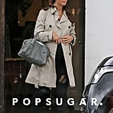 Kate Middleton covered her baby bump with a trench coat for an antique-shopping outing in Hungerford, England.
