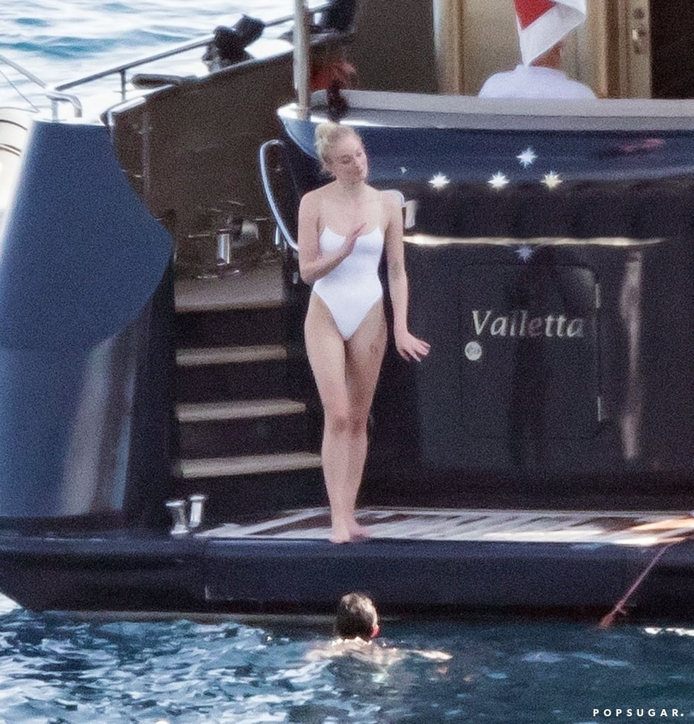 Sophie Turner Wearing a White One-Piece on Her Honeymoon