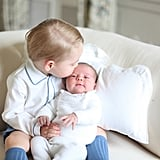 George gave Charlotte a kiss during the baby's first official photo shoot in May 2015.