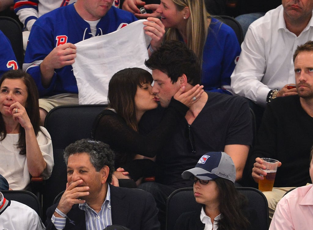Cory Monteith and Lea Michele kissed in the stands at a hockey game in Madison Square Garden last night. They watched the New Jersey Devils beat the New York Rangers in the Eastern Conference Finals. The teams will go head to head again in the next match of their series on Saturday. Lea was rooting for the Rangers, but she seemed more focused on showing her boyfriend love during the action. It was just the couple's latest show of affection after they stepped out holding hands earlier in the day. Lea and Cory went shopping in SoHo after attending the FOX Upfront presentation for Glee on Monday. Their hit show has only one more episode before the season finale, but it will be back this Fall in a new time slot on Thursdays.