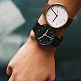 Find two watches with the same sleek, round face, and rock them in two colorways.