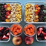 Brown rice, corn, tomatoes, beans, spinach, and fresh fruit.
