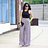 A Black Top, Patterned Trousers, and Heels
