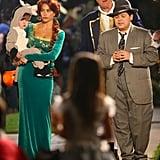 Sofia, Ed (Jay), and Rico Rodriguez (Manny) filmed a street scene.