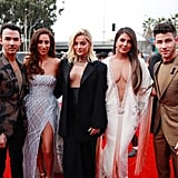 Bebe Rexha, Priyanka Chopra, and Kevin, Danielle, and Joe Jonas at the 2020 Grammys