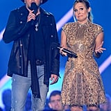 Jason Aldean and Kristen Bell on stage at the CMT Awards.