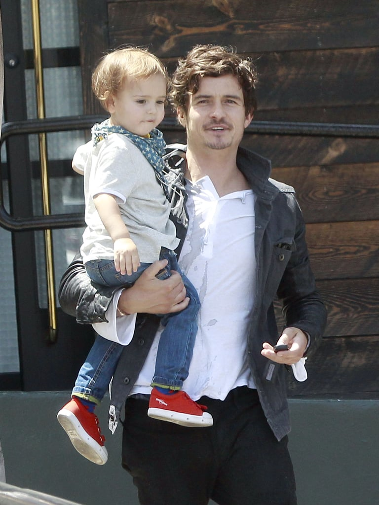 Orlando Bloom carried his son, Flynn Bloom.