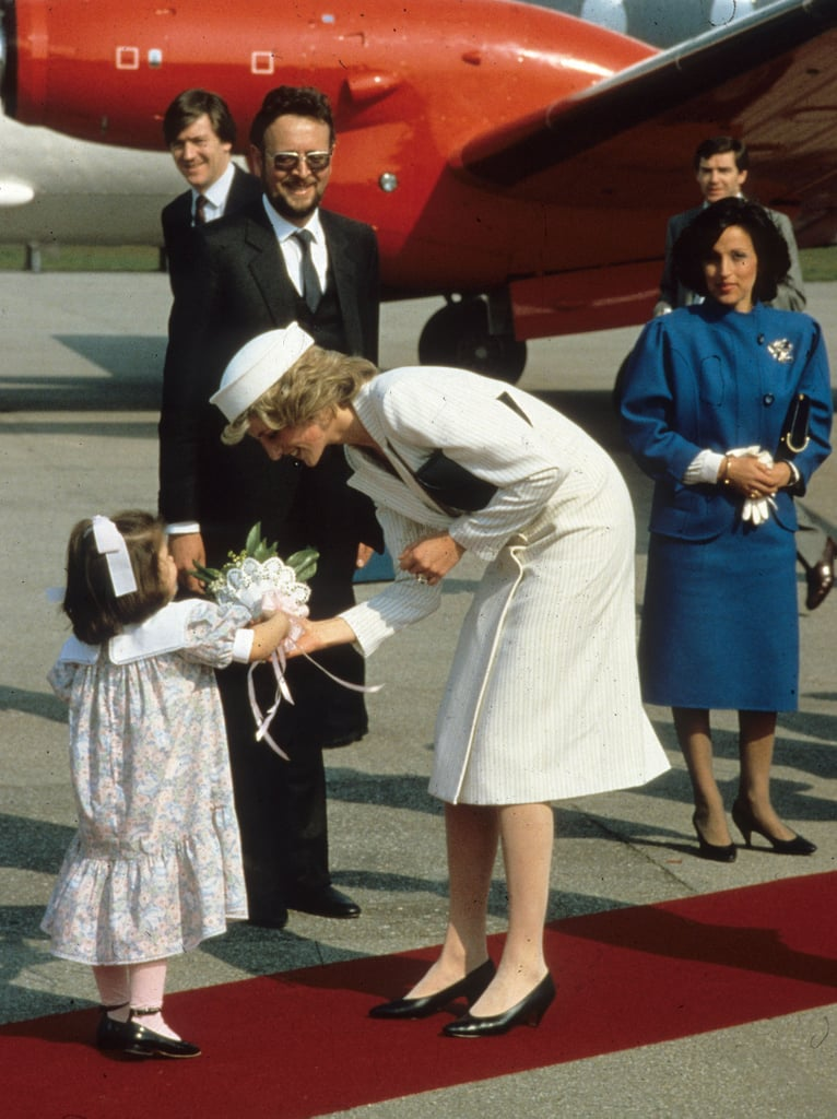 Diana accepted flowers from a young girl after landing in La Spezia, Italy, in April 1985.