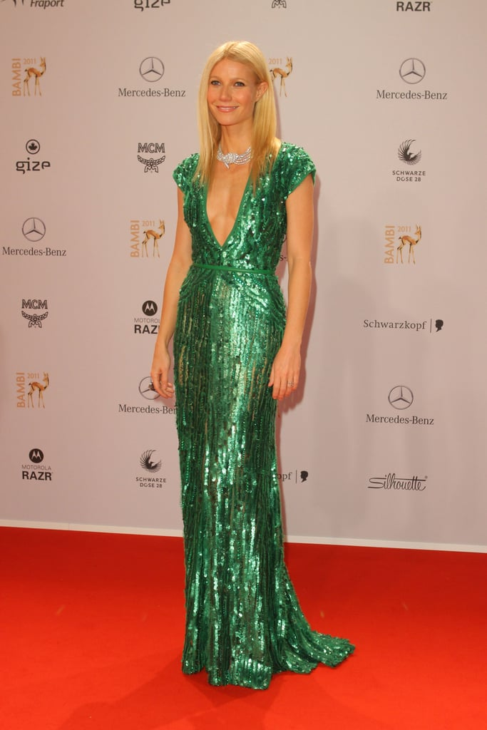 Gwyneth Paltrow looked glamorous in an emerald gown by Elie Saab at the Bambi Awards in Wiesbaden, Germany today. She arrived with pal Kevin Matthew Keating, who also accompanied her to this year's Emmys. Gwyneth wasn't the only famous face at the event since Justin Bieber also made an appearance to accept his entertainment honor and Lady Gaga was on hand as the recipient of the Golden Deer award.  Gwyneth's gorgeous red carpet evening comes after she spent another fun night out with friends in London this week. She was spotted at the Mayfair Arts Club with Stella McCartney on Tuesday and perhaps the ladies were celebrating Gwyneth's People's Choice Award nomination for favorite TV guest star. Voting is open so place your picks before the big show in January.