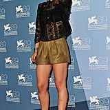Earlier in the day, Carole Combes paired leather shorts with a peekaboo lace top.