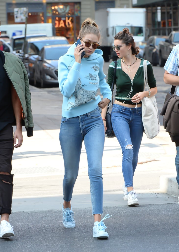 Wearing Mother skinny jeans with a blue hoodie and sneakers.