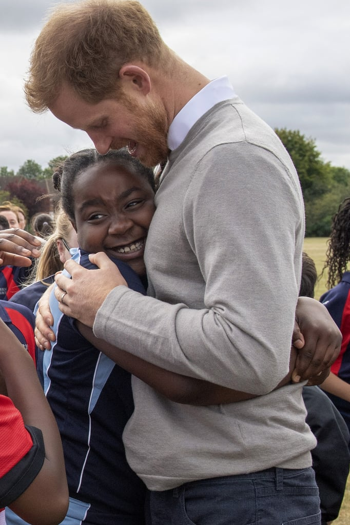 "It's always a delight when Prince Harry steps out for a royal engagement, but his latest visit to Luton's Lealands High School on Thursday was genuinely adorable. While Meghan Markle was busy launching her first-ever fashion collection with Smart Works, the Duke of Sussex visited students from the Rugby Football Union All Schools program. The initiative encourages kids to stay active by playing rugby, and the 34-year-old royal looked so happy to be there as he handed out hugs and high fives to a group of excited students.  Even though hugging technically goes against royal protocol, Harry previously told journalist Angela Levin that he's an excellent hugger. ""Everyone needs a hug now and again, and it just so happens that I'm very good with hugs,"" he said.  Both Harry and Meghan were glowing during their Thursday outings, and I'm wondering if it may have something to do with their upcoming tour of South Africa. The Duke and Duchess of Sussex will kick off their trip with baby Archie in Cape Town on Sept. 23, and it'll include stops in Johannesburg, Botswana, Angola, and Malawi. Who else is excited?      Related:                                                                                                           Prince Harry's Net Worth Is, Well, Downright Princely"