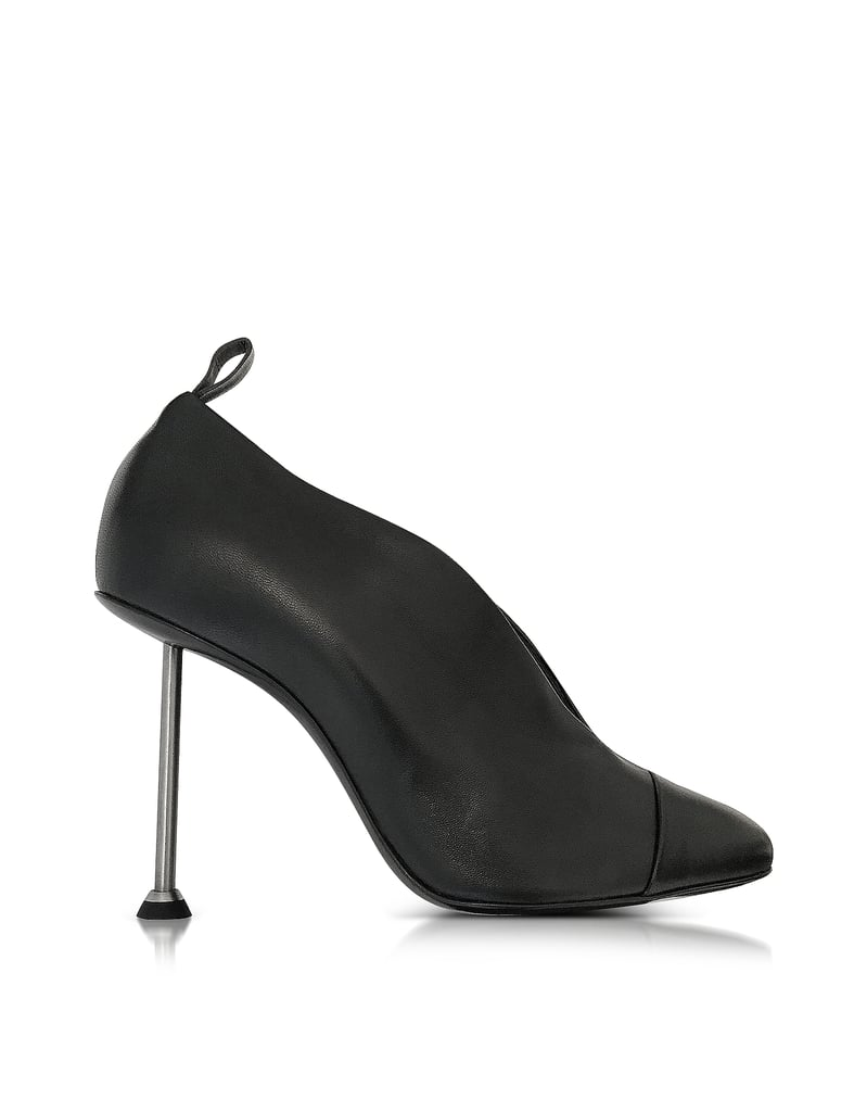 Victoria Beckham famously stomped around New York in her nail-heeled Pin Black Leather Pumps ($980) prior to their debut.