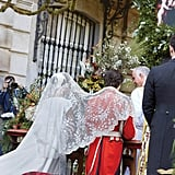 She Also Wore a Lace Veil During the Ceremony