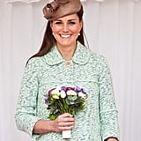 Attending the National Review of Queen's Scouts at Windsor Castle earlier this year, Kate looked stunning in a mint ensemble. She wore her classic blowout straight, with it pinned half up underneath her fascinator.