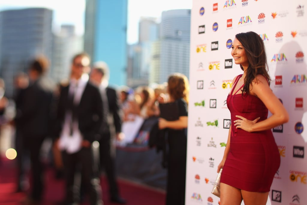 Ricki-Lee works her curves in that bandage dress.