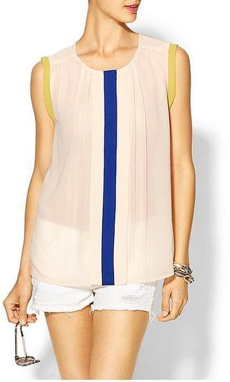A cool color story and a flowy silhouette make this Tinley Road colorblock pleated blouse ($49) a favorite of ours.