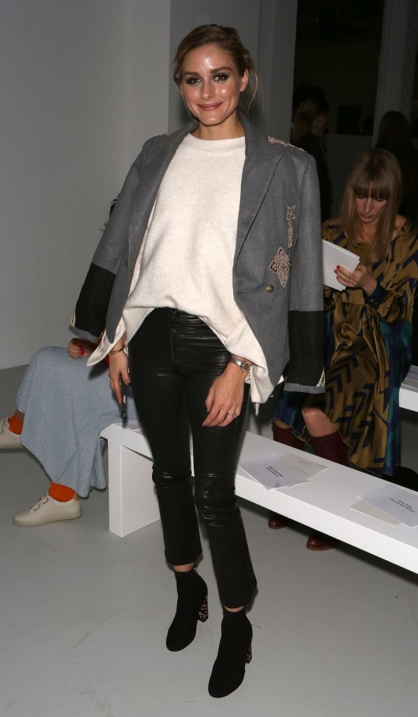 While taking in the shows in London, the fashion pro reworked leather pants with a sweater and blazer thrown casually over her shoulders.