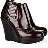 We'd pair these sleek ankle boots with pleated skirts and drop-waist dresses.  Burberry Chelsea Wedge Ankle Boots ($695)