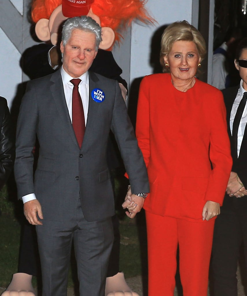 "To say that Katy Perry is a huge fan of presidential nominee Hillary Clinton is an understatement. On Friday, the ""Rise"" singer attended Kate Hudson's annual Halloween bash in LA dressed up as none other than Hillary herself. Not only did Katy completely nail her costume with the help of prosthetics, a wig, and her own secret service detail, but to make her costume even more spectacular, boyfriend Orlando Bloom fully transformed into Hillary's opposing candidate, Donald Trump, and one of her friends went as Bill Clinton. Katy, who's been actively campaigning for Hillary, posted an Instagram photo earlier in the evening of her team getting her ready for the night, writing, ""Having a little pre party before I take office #IMWITHME Cheers to @svedkavodka  #howtosvedka @hillaryclinton 🍸✨."" All politics aside, we have to admit Katy and Orlando crushed their Halloween costumes.       Related:                                                                                                           Look Back on Last Year's Sexy, Scary, Silly Halloween Costumes"