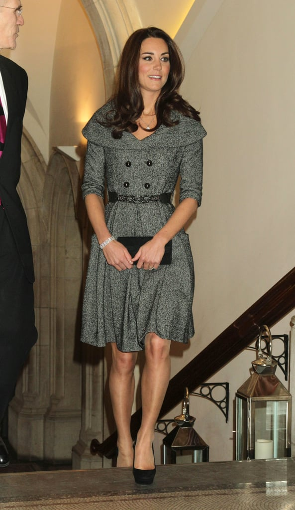 Kate Middleton, wearing a dress from the UK store Jesire, undertook a solo appearance this evening in London. With her husband, Prince William, away in the Falklands, she's now focusing on the institutions near to her heart. At the end of 2011, Kate announced her plans to become a royal patron of London's National Portrait Gallery. She has a long-standing interest in painting, having studied art history when an undergraduate at St. Andrew's in Scotland. Today, she stepped out to check out the museum's new exhibit from recently deceased London painter Lucian Freud. It was Kate's first solo public appearance since marrying William back in April of 2011. There may soon be a more permanent royal feature at the National Portrait Gallery. It was announced today that Kate will pose for a portrait bound for the museum.