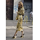 "Anna Dello Russo went star-spangled in a tea-length Dolce & Gabbana sequin dress and YSL wedges during Spring 2012 Milan Fashion Week Shop the look: <iframe src=""http://widget.shopstyle.com/widget?pid=uid5121-1693761-41&look=4300246&width=3&height=3&layouttype=0&border=0&footer=0"" frameborder=""0"" height=""244"" scrolling=""no"" width=""286""></iframe> Photo: Phil Oh"