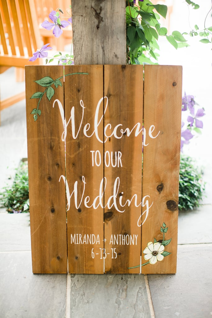 Welcome guests with a calligraphic wooden sign.