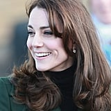 Kate completed her look with dainty drop earrings.