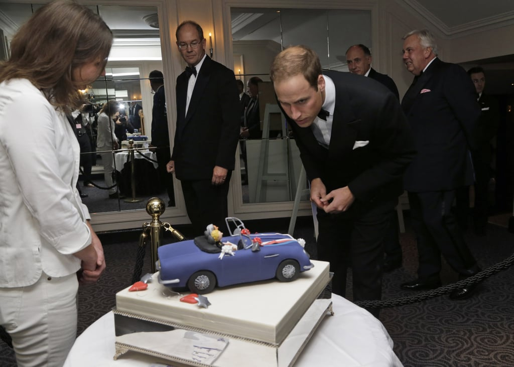 Prince William was presented with a cake at The October Club dinner in London.