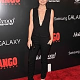 Olivia Wilde stunned in a deep V-neck black jumpsuit and velvet pumps.