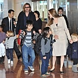 Angelina held onto Pax and Viviene while Brad had Shiloh and Knox on either hand.