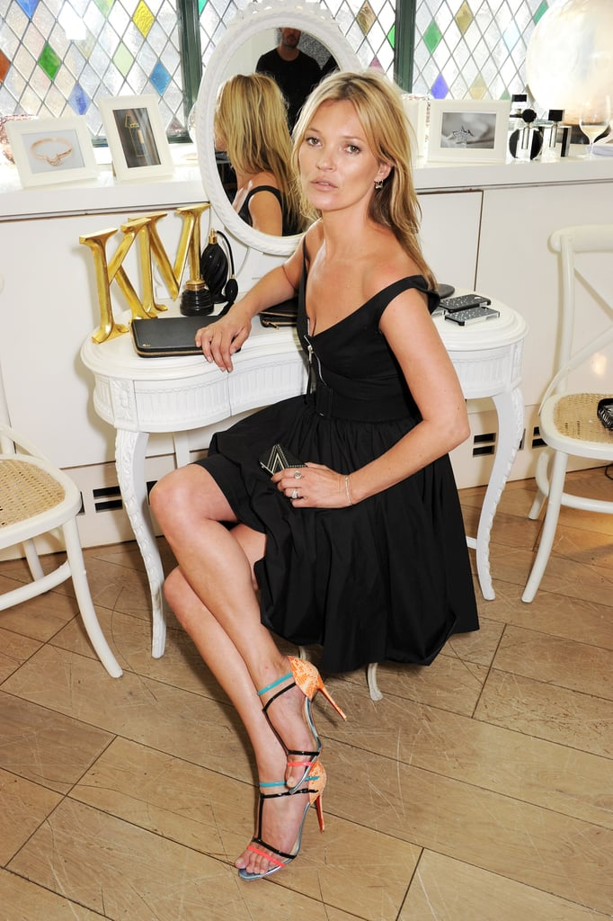 Kate Moss promoted her line of tech accessories at a design preview in London.