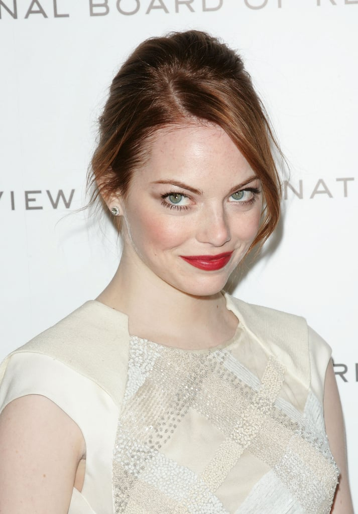 Emma Stone's red lipstick popped against her white dress.