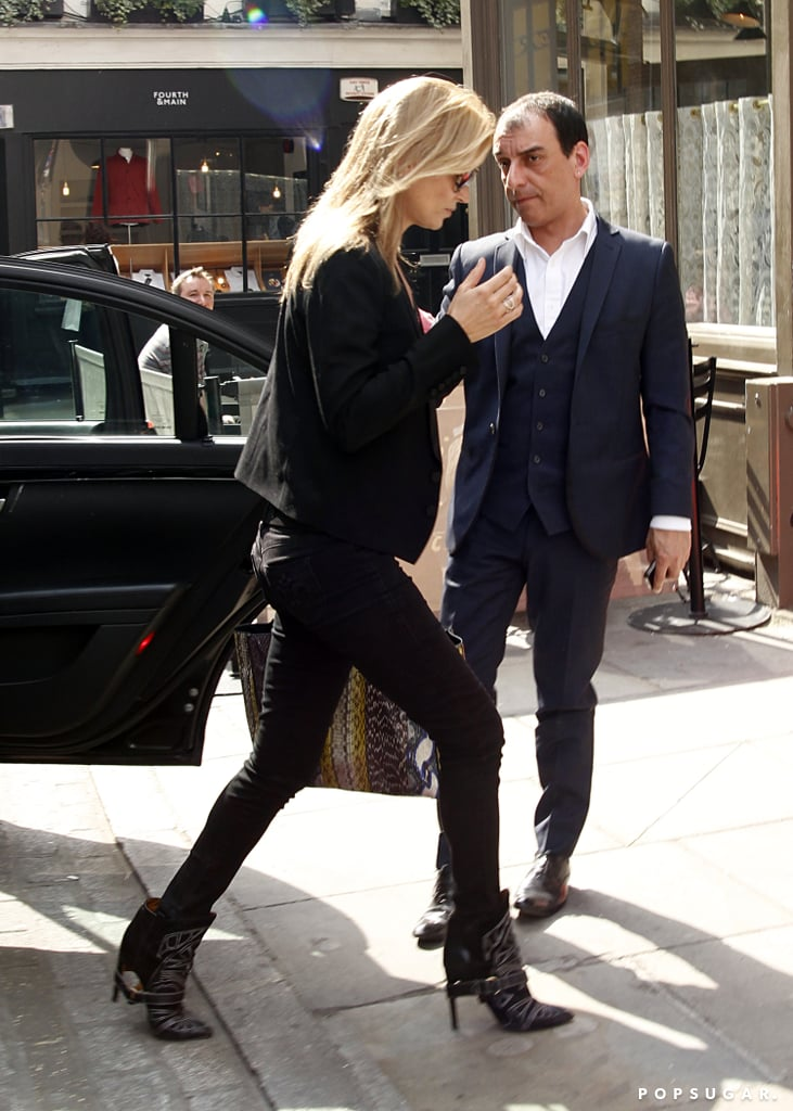 Kate Moss wore black skinny jeans and a black tuxedo jacket.