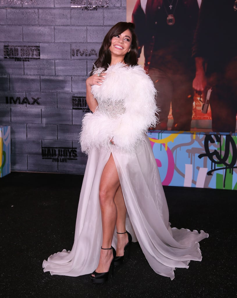 Now this is what you wear after a breakup. The same day news broke of her split from Austin Butler after nearly nine years of dating, Vanessa Hudgens attended the Bad Boys For Life premiere in Los Angeles looking impossibly glamorous.  Evoking an Old Hollywood feel, Vanessa's red carpet outfit consisted of a white Georges Hobeika dress featuring a semisheer skirt, beaded bodice, and feathery asymmetrical neckline, which then extended down and wrapped around her waist. Stylist Jason Bolden completed the look with black Casadei platform heels and a stunning Gismondi 1754 statement ring with a six-carat white diamond and three-carat emerald.  In photos from the premiere, Vanessa seemed to exude confidence as she twirled in her dress and struck many playful poses. Check out her lavish look ahead.      Related:                                                                                                           These Glamorous Oscars Gowns Will Have You Counting the Seconds Till the 2020 Oscars