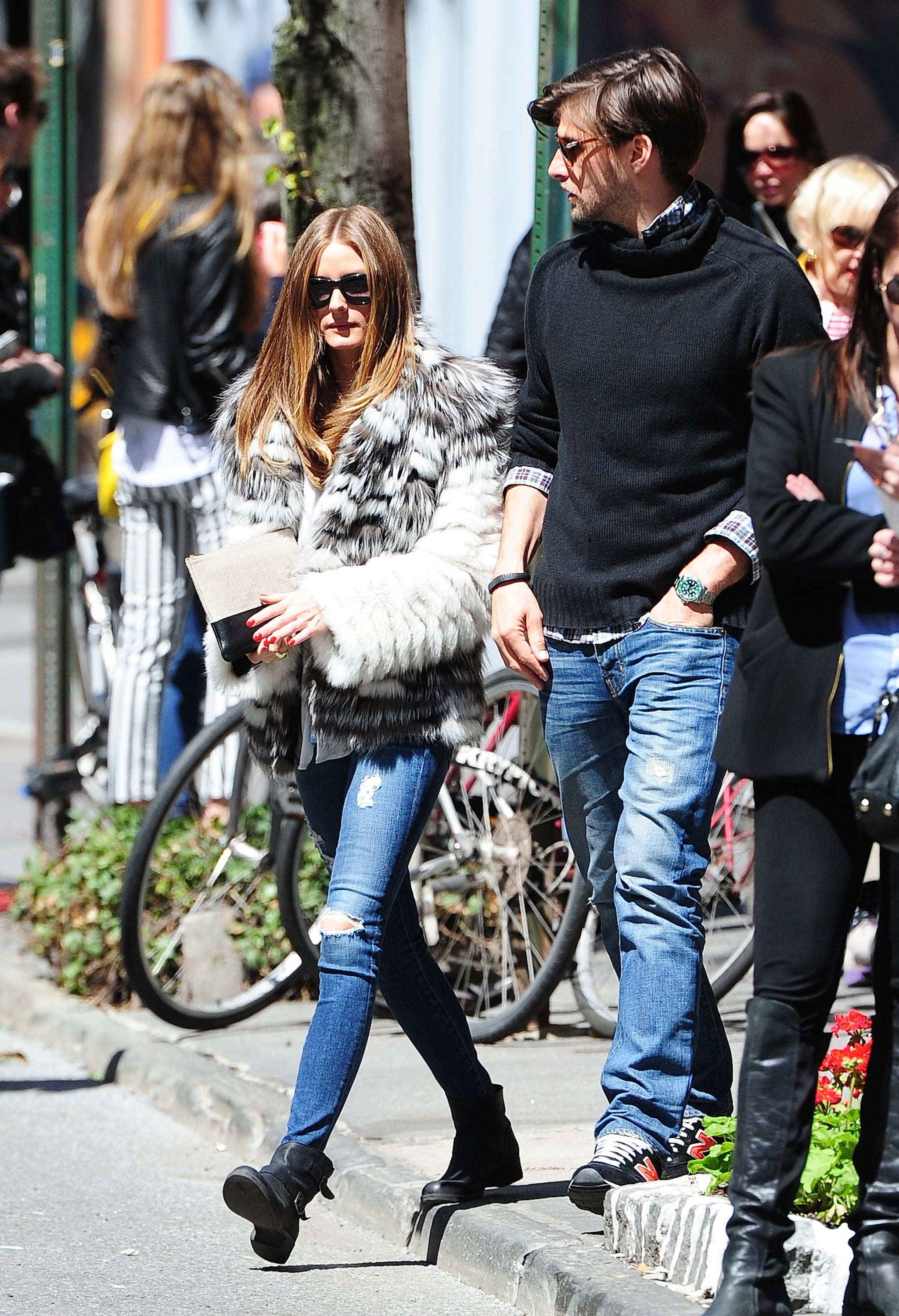 Olivia bundled up in a furry coat and skinny distressed denim for a perfect play on downtown-cool.