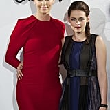 Charlize Theron wore red while Kristen Stewart went with a darker dress for the Snow White and the Huntsman photocall in Madrid.