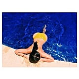Kim shared this photo of herself lounging in the pool in Mexico in July 2014. Source: Instagram user kimkardashian