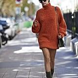 Sara Sampaio Wore an Oversize Orange Sweater and Grey Booties in Paris