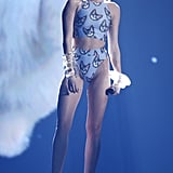The star radiated major cat-titude in a feline-print duo and and lucite accessories at the 2013 American Music Awards.